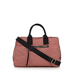 Red Herring - Light pink quilted holdall
