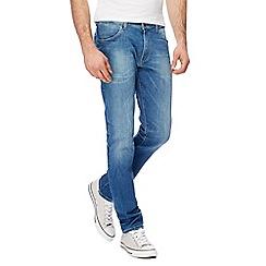 Wrangler - Mid blue 'Larston' slim tapered jeans