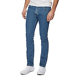 Wrangler - Blue 'Larston' light wash slim tapered jeans