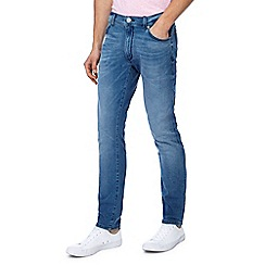 Wrangler - Blue mid wash 'Larston' slim fit jeans