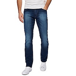 Wrangler - Dark blue mid wash straight leg jeans