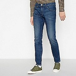 Wrangler - Blue Mid Wash 'Bryson Overboard' Skinny Fit Jeans