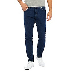 Wrangler - Blue mid wash 'Larston' slim tapered fit jeans