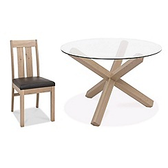 Debenhams - Oak and glass 'Turin' round table and 4 slatted back chairs