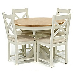 Willis & Gambier - Oak top 'Newquay' round extending dining table and 4 cross back dining chairs with cream seats