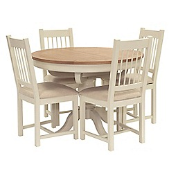 Willis & Gambier - Oak top 'Newquay' round extending dining table and 4 spindle back dining chairs with beige seats
