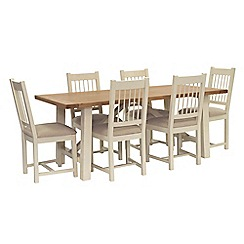 Willis & Gambier - Oak top 'Newquay' trestle dining table and 6 spindle back dining chairs with cream seats