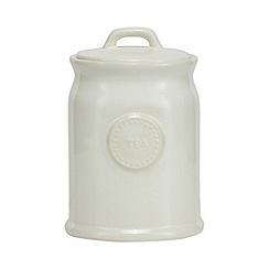 At home with Ashley Thomas - Cream ceramic tea jar