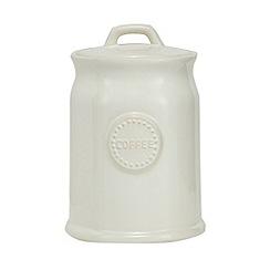 At home with Ashley Thomas - Cream ceramic coffee jar
