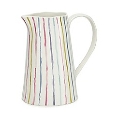 At home with Ashley Thomas - Multi-coloured stripe jug