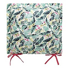 At home with Ashley Thomas - Green tropical print seat pad