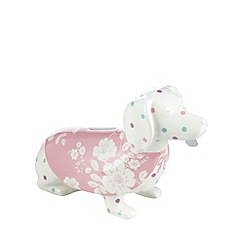 At home with Ashley Thomas - Stoneware dachshund shaped money box