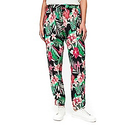 Wallis - Black tropical print zipped trousers