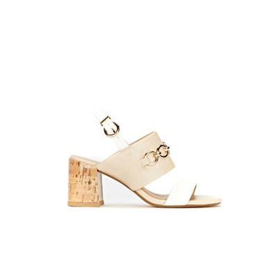 Extra wide fit tan laser cut flare heels