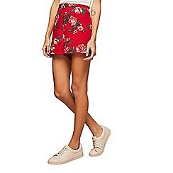 Miss Selfridge - Red print flippy shorts