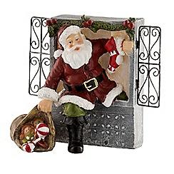 Aynsley China - Santa climbing through the window figurine
