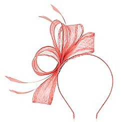 Precis - Coral feather fascinator