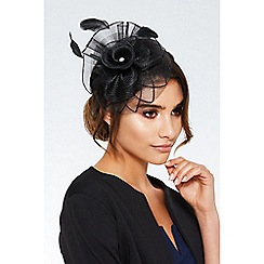 Quiz - Black flower spiral fascinator