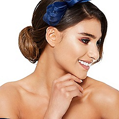 Quiz - Navy bow feather headband fascinator
