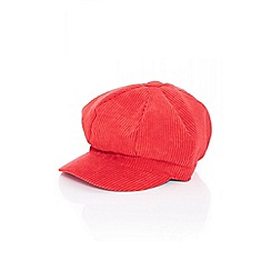 Quiz - Red cord baker boy hat