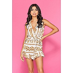 Quiz - TOWIE cream and gold scarf print frill playsuit