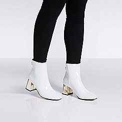 Quiz - White patent gold heel ankle boots