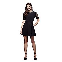 Mela London - Black floral print 'Misha' mini skater dress