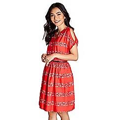 Yumi - Red cold shoulder swimmer 'aayat' print dress