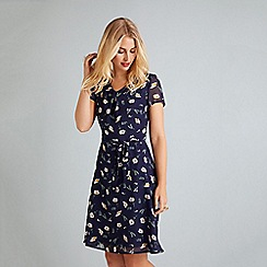 Yumi - Navy daisy print tie waist skater dress