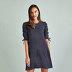 Yumi - Navy polka dot 'Elizza' tunic dress