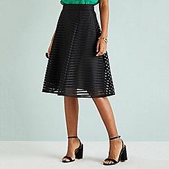 Yumi - Black fishnet skirt