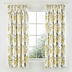 Sanderson - Pale yellow 'Wisteria Blossom' curtains