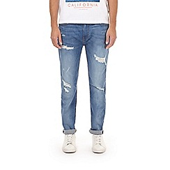 Burton - Light wash mid blue tapered fit jeans