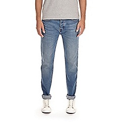 Burton - Light blue wash stretch tapered jeans