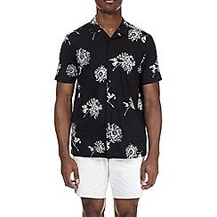 Burton - Short sleeve black spaced floral print shirt