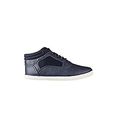 Burton - Navy leather look sports shoes on a white sole with a padded cuff