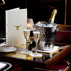 Buyagift - Three Course Champagne Celebration Dining at Marco Pierre White's Steakhouse Gift Experience for 2